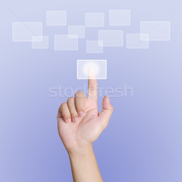 Hand pointing, touching or pressing on purple background Stock photo © nuiiko