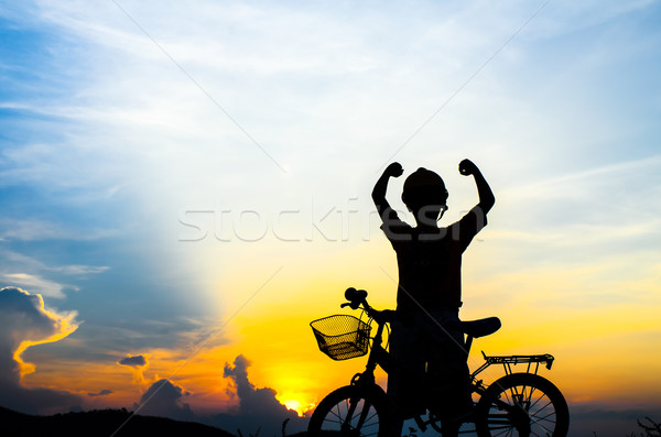 Silhouette of the cyclist riding a road bike at sunset Stock photo © nuiiko
