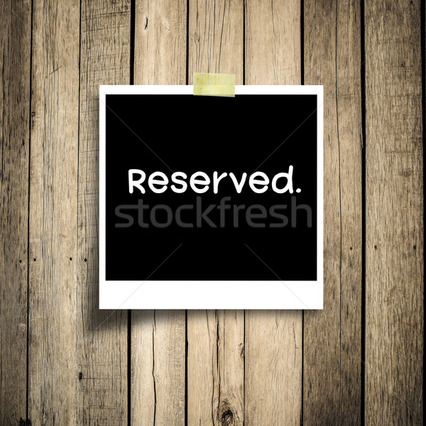 Reserved message  grunge wooden background with copy space Stock photo © nuiiko