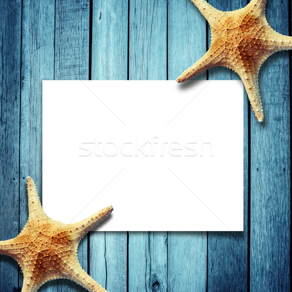 Star fish and card on a wooden boards Stock photo © nuiiko