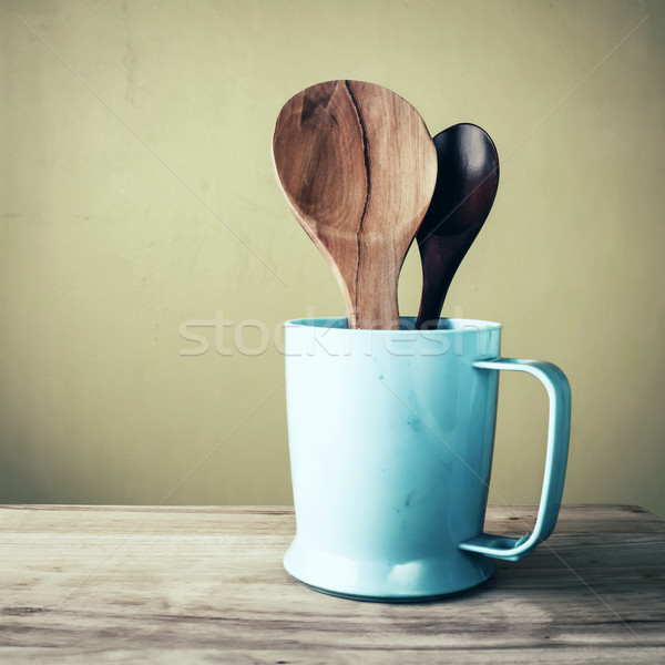 Wooden ladles in plastic glass, vintage stlye Stock photo © nuiiko
