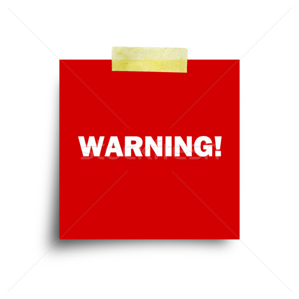 Stock photo: Warning on red paper note isolated on white