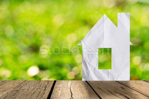 White paper house and spring green grass with green bokeh and su Stock photo © nuiiko