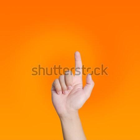 Hand wijzend aanraken oranje vrouw Stockfoto © nuiiko