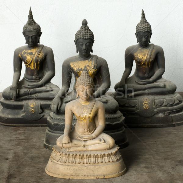 Lumière pierre buddha trois sombre statue Photo stock © nuttakit