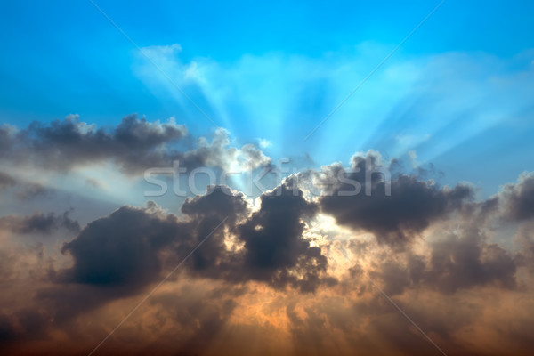 Abstract sunrise behind dark cloud Stock photo © nuttakit