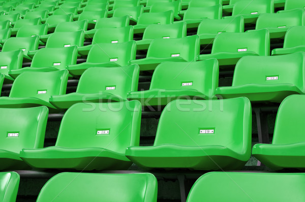 Green Empty plastic seats at stadium Stock photo © nuttakit
