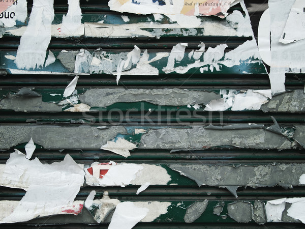Torn paper on the old steel panel Stock photo © nuttakit