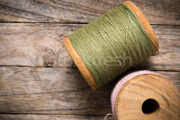 Reel pink with green yarn right side on wood Stock photo © nuttakit