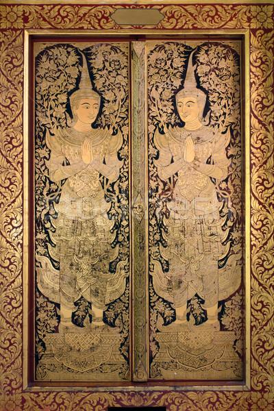 Thai ancient art Gold angel painting on church door Stock photo © nuttakit