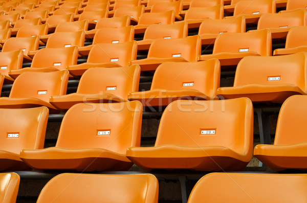 Orange Empty plastic seats at stadium Stock photo © nuttakit