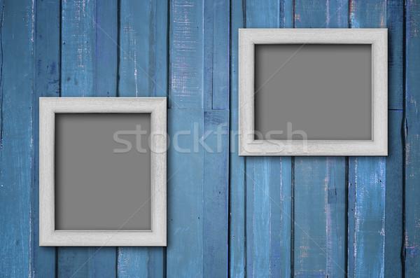 Blanche bois cadre photo bleu mur deux Photo stock © nuttakit