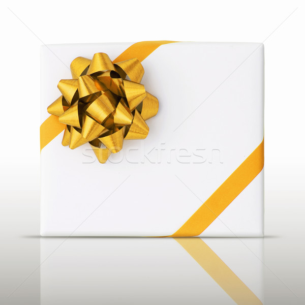 Gold star and Oblique line ribbon on White paper box Stock photo © nuttakit