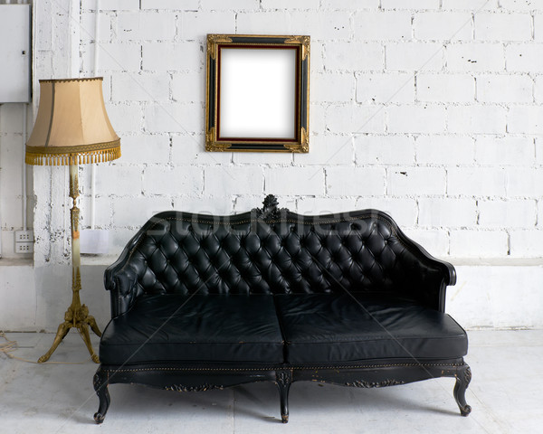 Old black leather sofa with lamp and wood picture frame Stock photo © nuttakit
