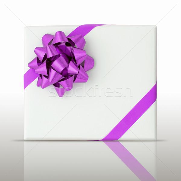 Purple star and Oblique line ribbon on White paper box Stock photo © nuttakit