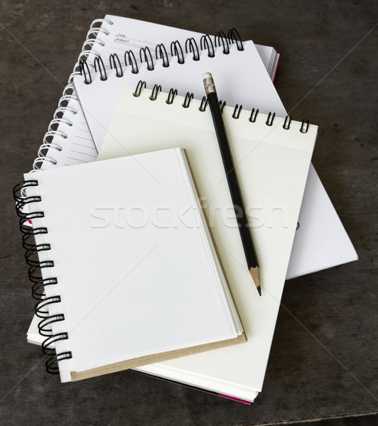Four Notebook overlapping Stock photo © nuttakit