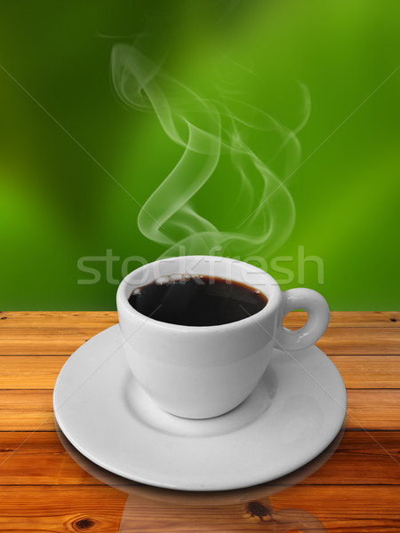 Cup of hot coffee on wood table Stock photo © nuttakit