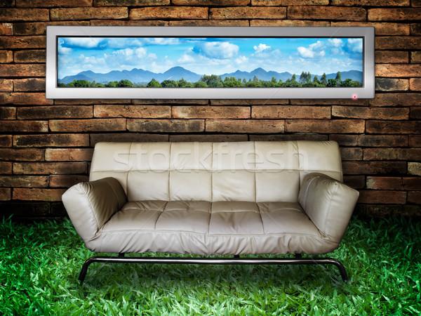 White sofa Brick Wall and Green Grass Stock photo © nuttakit