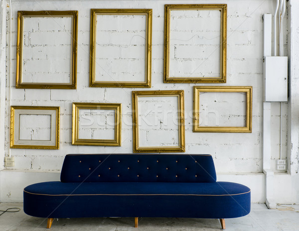 Long blue fabric sofa and gold picture frame Stock photo © nuttakit