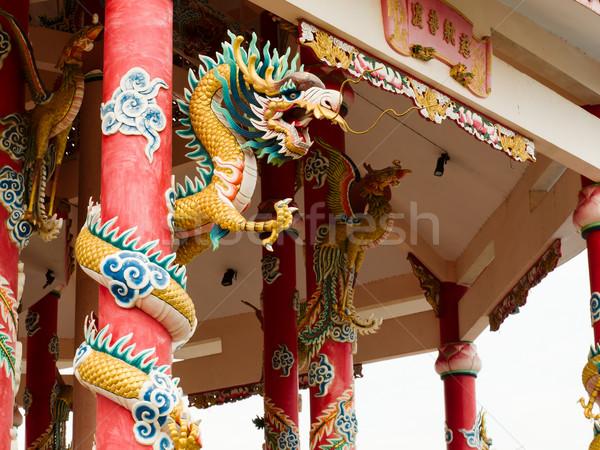 Left Golden gragon statue on red pillar Stock photo © nuttakit