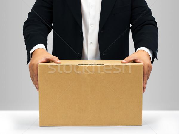 Imprenditori tenere giù carta marrone finestra abito nero Foto d'archivio © nuttakit