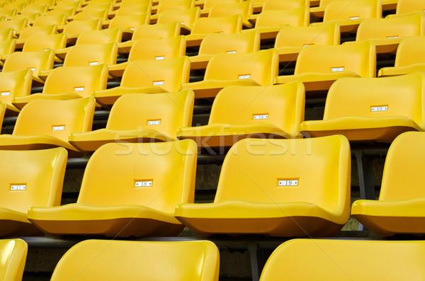 Yellow Empty plastic seats at stadium Stock photo © nuttakit