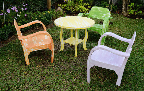 The three wood chairs with armrest and yellow round table Stock photo © nuttakit
