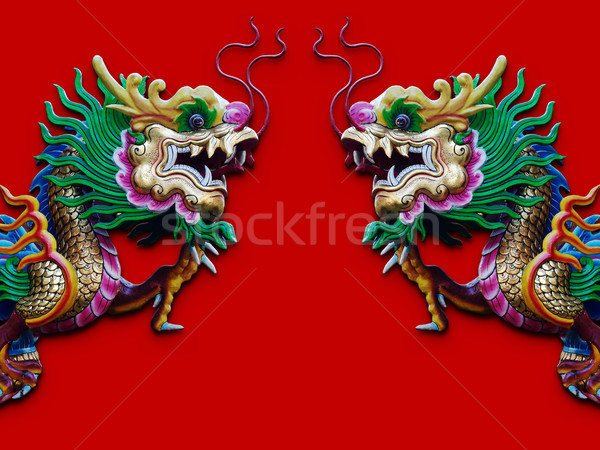 Twin Chinese Dragon statue isolated on red Stock photo © nuttakit