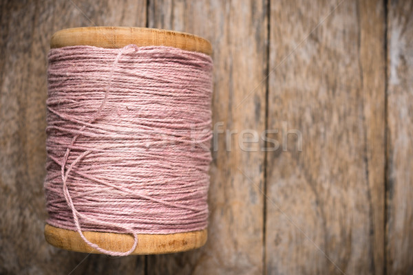 Reel pink yarn left side on wood Stock photo © nuttakit