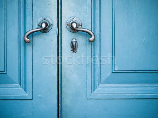 Starych drzwi podwoić malowany niebieski budynku Zdjęcia stock © nuttakit