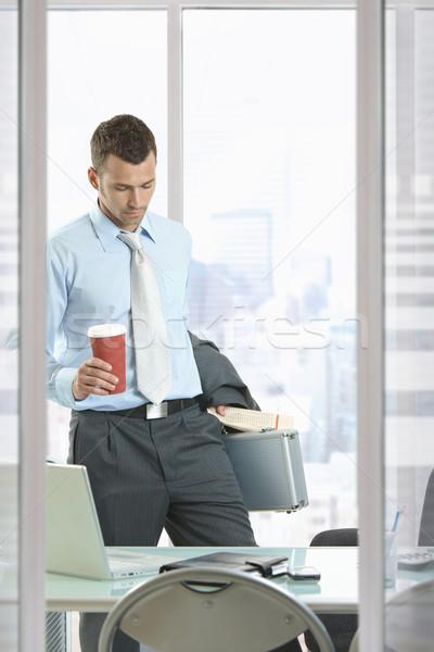 Stock photo: Businessman leaving office