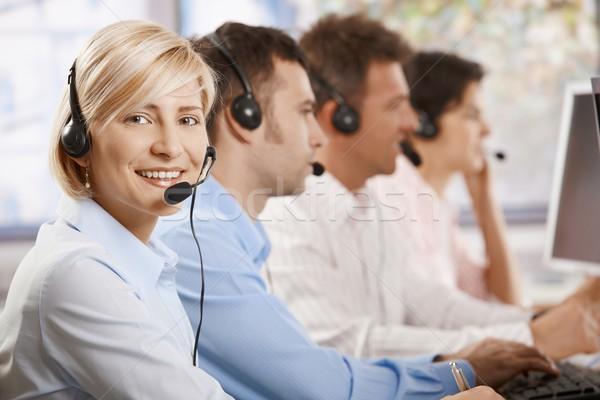 обслуживание клиентов счастливым женщины оператор гарнитура глядя Сток-фото © nyul
