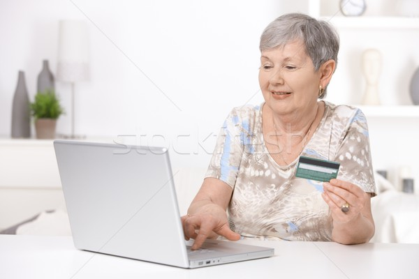 Senior woman shopping on internet Stock photo © nyul