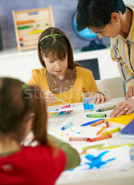Elementary age schoolgirls painting Stock photo © nyul