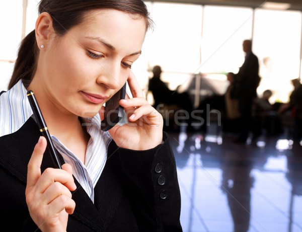 Businesswoman calls on cellphone Stock photo © nyul