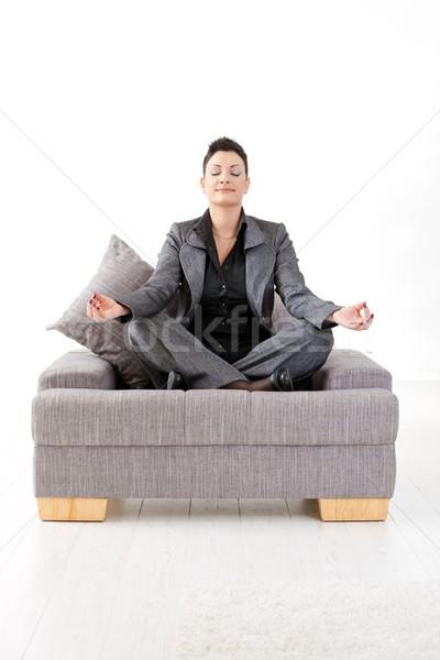 Stock photo: Meditating businesswoman