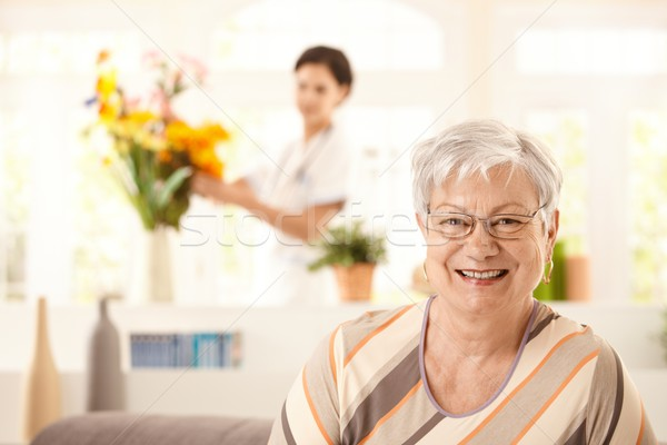 Stock photo: Portrait of happy elderly woman