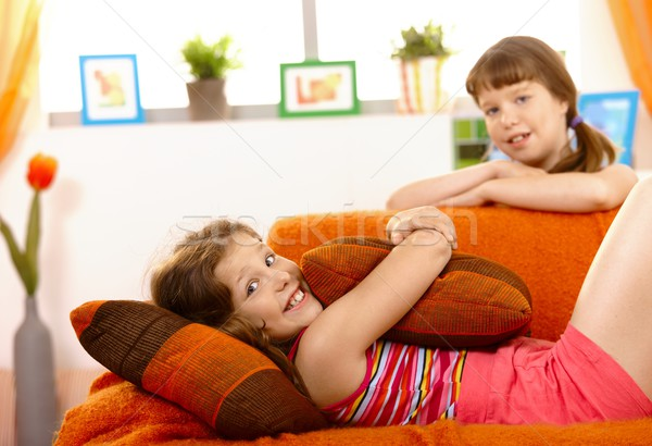 Stock photo: Cute small girl on sofa