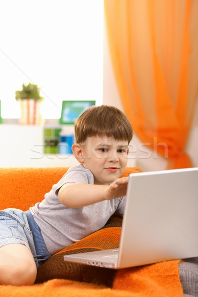 Five year old with computer Stock photo © nyul