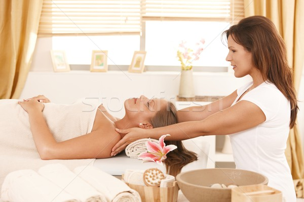 Young woman getting massage in day spa Stock photo © nyul