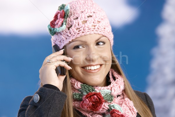 Attractive woman in winter clothes with mobile Stock photo © nyul