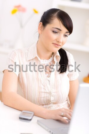 Daydreaming young woman sitting on floor Stock photo © nyul
