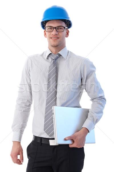 Stockfoto: Jonge · ingenieur · glimlachend · veiligheidshelm · laptop