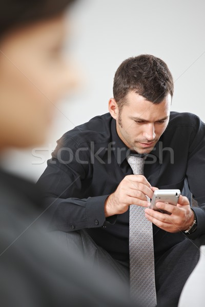 Businessman using palmtop Stock photo © nyul