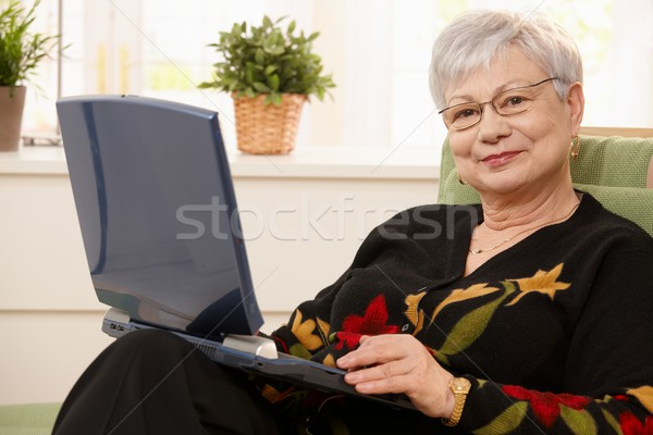 Portrait of elderly lady with computer Stock photo © nyul