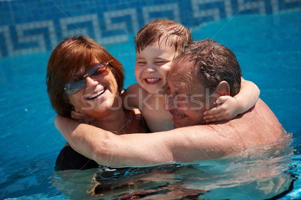 Nagyszülők unoka boldog család fürdőkád medence együtt Stock fotó © nyul