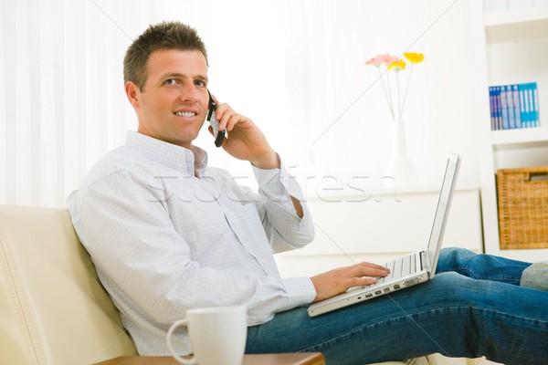 Işadamı konuşma cep telefonu gündelik çalışma ev Stok fotoğraf © nyul