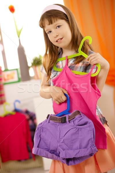 Portré kicsi lány bemutat ruházat kombináció Stock fotó © nyul
