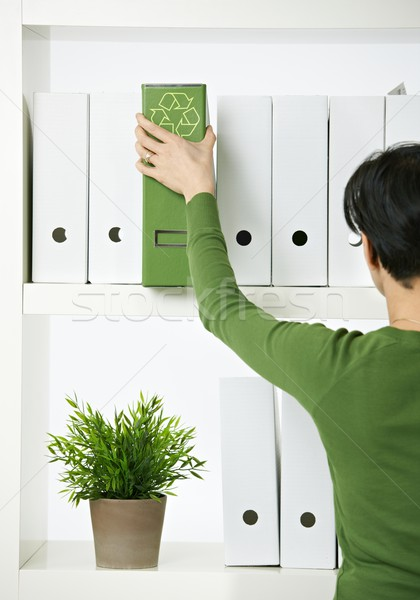 Female office worker with green folder Stock photo © nyul