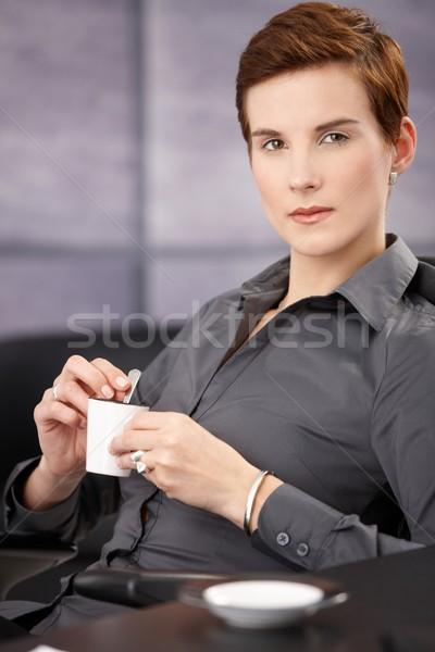 Portrait of businesswoman having coffee Stock photo © nyul
